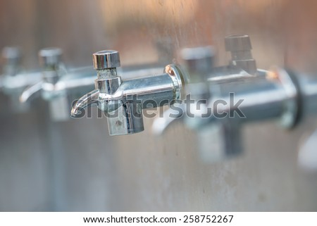 Bronze faucet of drink water - stock photo