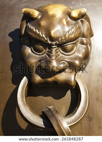 Bronze figure of lion head and handle, it's typical and traditional statues in Forbidden City, Beijing China. - stock photo