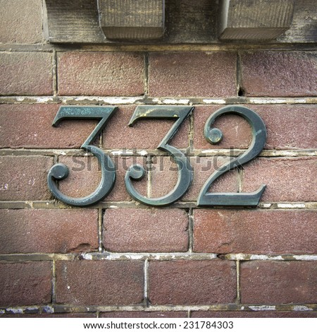 bronze house number three hundred and thirty two - stock photo