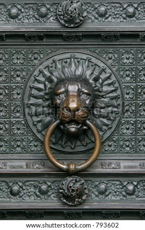 Bronze knocker in the shape of a lion head from the gate of the Cologne Cathedral, Germany - stock photo