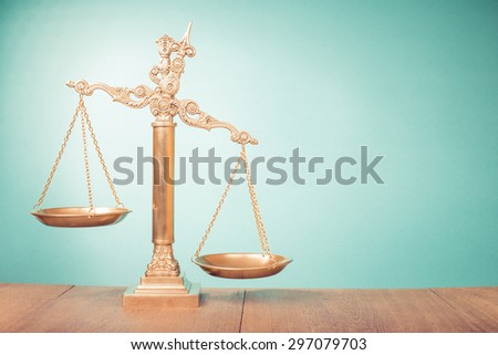 Bronze law scales on table. Symbol of justice. Retro old style filtered photo - stock photo