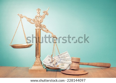 Bronze law scales with dollars cash money and judge gavel - stock photo