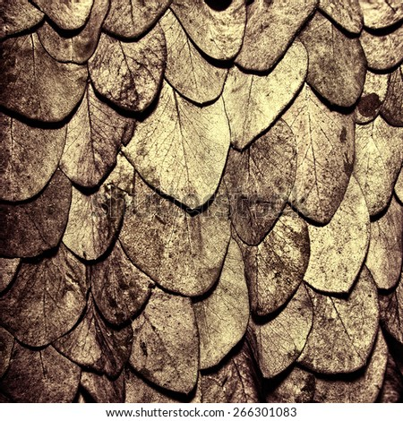 Bronze leaves background in the form of scales of a snake - stock photo