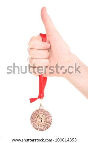 Bronze medal in hand isolated on white - stock photo