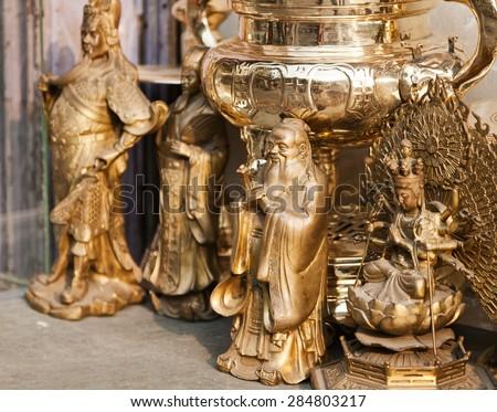 Bronze religious figures at the flea market in  Asia - stock photo