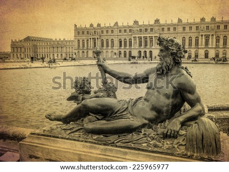 bronze sculpture at the garden of Versailles palace on old background texture  - stock photo