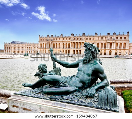 bronze sculpture in the garden of Versailles palace near Paris, France with blue sky (composition) - stock photo