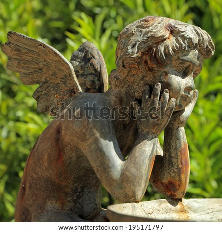 bronze sculpture of angel - detail of the fountain in garden of Villa Peyron in Fiesole, Florence, Tuscany, Italy, Europe - stock photo