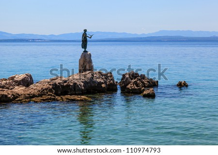 Bronze Sculpture of Maiden with Seagull on Background a Sea in Opatija, Croatia - stock photo