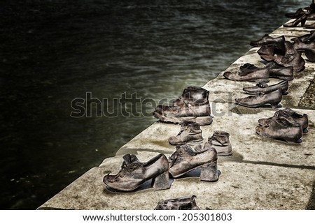 Bronze shoes on the Danube bank, holocaust memorial on the Pest side of the Danube river promenade honouring the jews killed during the world wide war II - stock photo