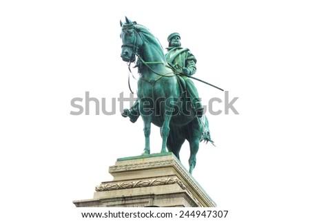 Bronze statue of Garibaldi on horse in Milan under rain isolated on white background - stock photo