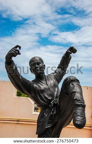 Bronze statue of Shaolin warriors monk in Chinese Temple Viharn Sien, Chonburi, Thailand.  - stock photo