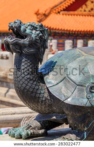 Bronze turtle near the Gate of Supreme Harmony in forbidden city in Beijing, China - stock photo