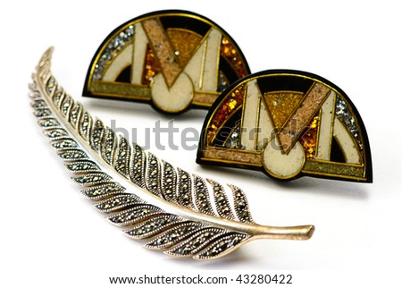 brooch and  earring on the  white background - stock photo