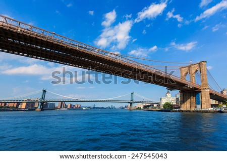 Brooklyn and Manhattan bridges from East River New York US - stock photo