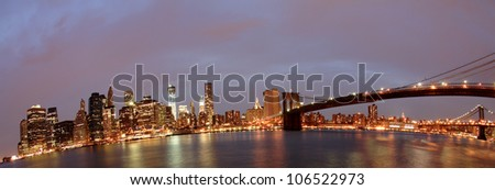 Brooklyn Bridge and Downtown Manhattan panorama from across east river - stock photo