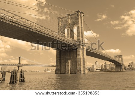 Brooklyn Bridge and East River with sepia filter tone, New York - stock photo