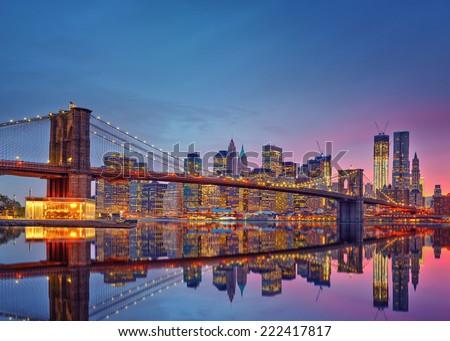 Brooklyn bridge and Manhattan at dusk, New York City - stock photo