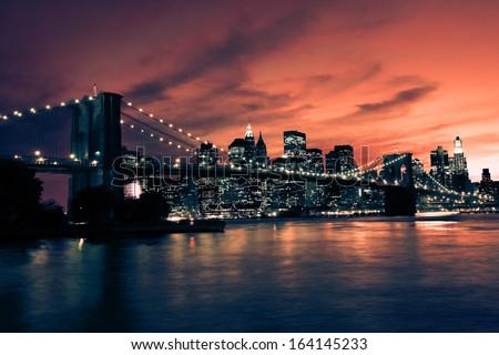 Brooklyn Bridge and Manhattan at sunset, New York, orange tone - stock photo