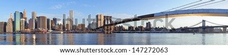 Brooklyn Bridge and Manhattan Bridge with lower Manhattan skyline panorama over East River in New York City - stock photo