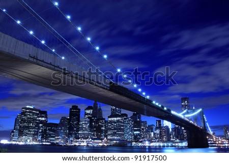 Brooklyn Bridge and Manhattan Skyline At Night, New York City - stock photo
