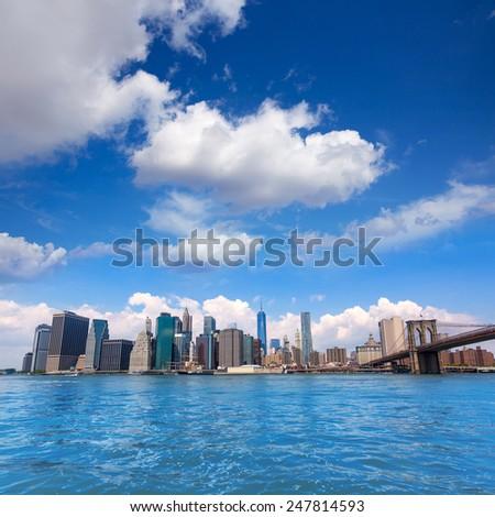 Brooklyn Bridge and Manhattan skyline New York city sunshine US - stock photo
