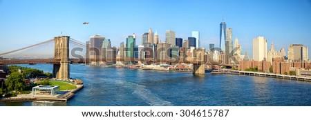Brooklyn Bridge and Manhattan skyline panorama in New York City - stock photo