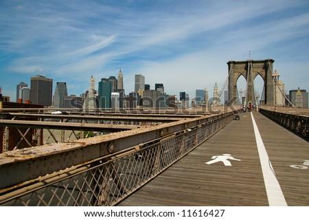 Brooklyn Bridge and Manhattan with cloudy sky - stock photo