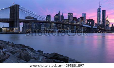 Brooklyn bridge and New York City Manhattan panorama at sunset - stock photo