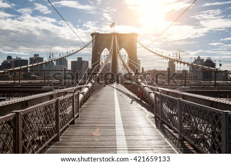 Brooklyn bridge and New York city sunlight - stock photo