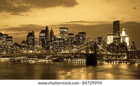 Brooklyn bridge and NYC skyline at sunset in sepia tone - stock photo