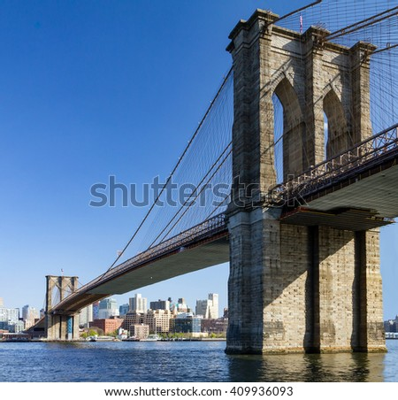 Brooklyn Bridge and Skyline seen from Manhattan, New York City - stock photo