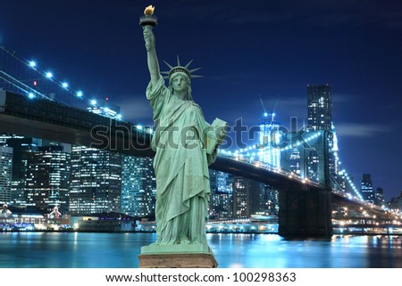 Brooklyn Bridge and The Statue of Liberty at Night Lights, New York City - stock photo