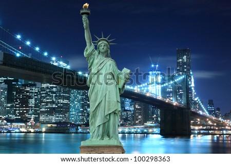 Brooklyn Bridge and The Statue of Liberty at Night Lights, New York City - stock photo