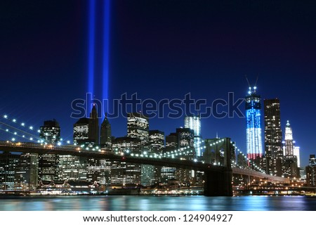Brooklyn Bridge and the Towers of Lights at Night, New York City - stock photo