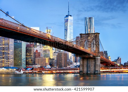 Brooklyn bridge and WTC Freedom tower at night, New York - stock photo