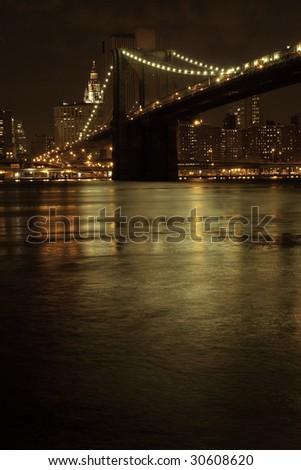 Brooklyn Bridge at night, New York, USA - stock photo