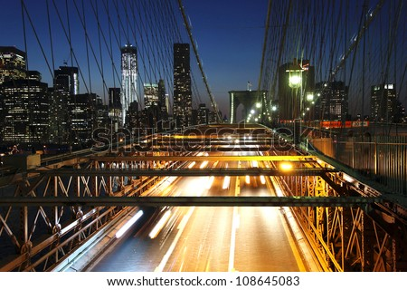 Brooklyn Bridge at night with car traffic - stock photo