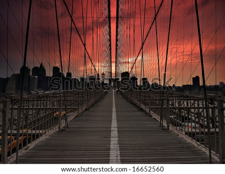 brooklyn bridge in a dramatic sunset - stock photo