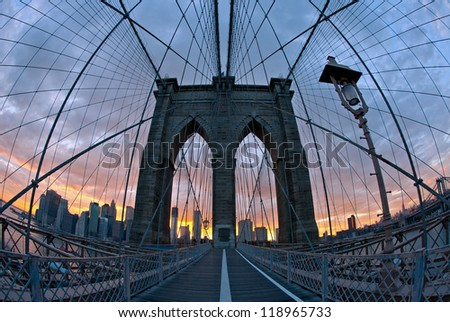 Brooklyn Bridge in New York at dusk. - stock photo