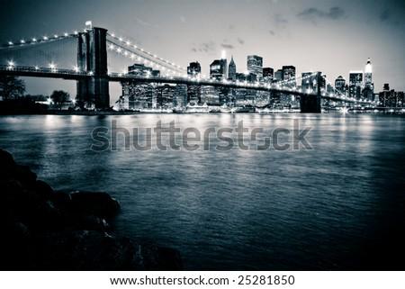 Brooklyn Bridge in New York at dusk - stock photo