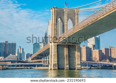 Brooklyn bridge in New York on bright summer day - stock photo