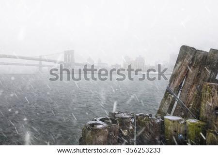 Brooklyn Bridge Through Snow - stock photo
