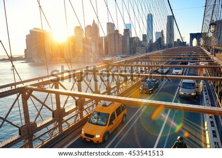 Brooklyn Bridge with traffic in downtown Manhattan New York City - stock photo