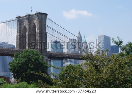 Brooklyn Bridge with Trees in Foreground - stock photo