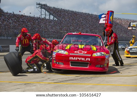 BROOKLYN, MI - JUN 17, 2012:  Jamie McMurray (1) brings in his McDonalds Chevrolet for service during the Quicken Loans 400 at the Michigan International Speedway in Brooklyn, MI. - stock photo