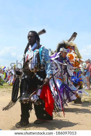 BROOKLYN, NEW YORK - JUNE 2:Unidentified Native American dancers at the NYC Pow Wow in Brooklyn on June 2, 2013. A pow-wow is a gathering and Heritage Celebration of North America s Native people  - stock photo