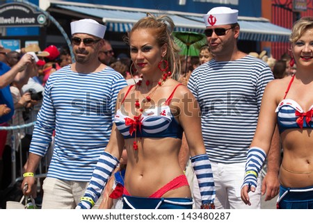 BROOKLYN, NEW YORK - JUNE 22: Unidentified participants of the 29th annual Coney Island Mermaid Parade on June 22, 2013 at Coney Island, Brooklyn, NY, USA. - stock photo