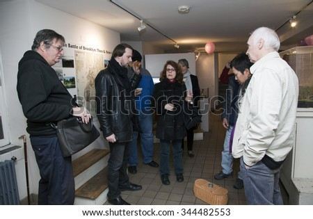 "BROOKLYN, NEW YORK, USA - NOVEMBER 22: Raymond Sawyers ""left center"" holds wooden cross as members of the borough paranormal meetup investigate the Old Stone House. Taken November 22, 2015 in NY. - stock photo"