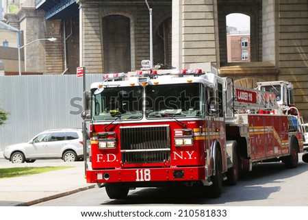 BROOKLYN, NY  - JUNE 17: FDNY Tower Ladder 118 truck in Brooklyn on June 17, 2014. FDNY is the largest combined Fire and EMS provider in the world  - stock photo